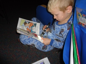 Tristan is practicing read to self with his flashlight!