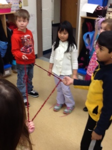 Kaleb, Linna, and Roshan make a triangle with their friends!