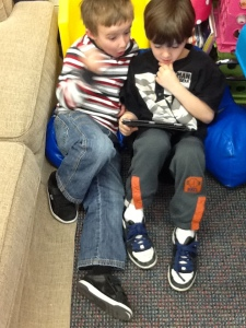 Curtis and Jonny are practicing spelling their kindergarten words via the spellingcity app on a classroom iPad!