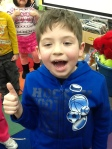 Admir has his thumbs up showing us what it feels like to be proud!