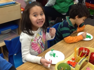 Jasmine is all smiles about her green eggs!