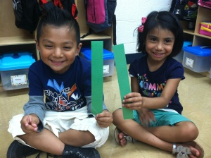 Brian and Audrey are matching the lengths of paper strips in our first Everyday Math Lesson.