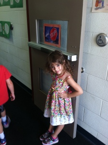 Noora is being such a safe and responsible kindergartener and showing her Clive Pride while she holds that door!