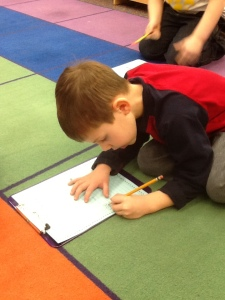 Cason is hard at work writing 100 words!